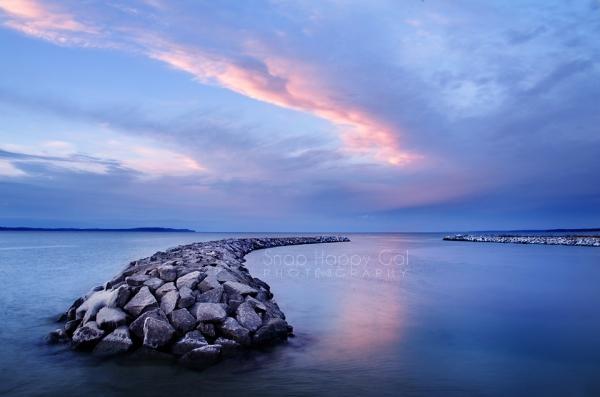 Photo: sunset reflections, Elk Rapids harbor