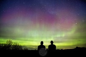 Silhouette of Friends taking in the Northern Lights show