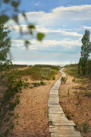 Photo: A boardwalk leads to a sunny Lake Michigan beach