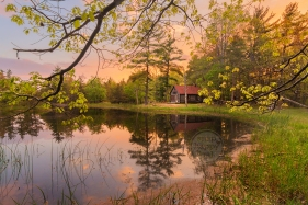 Photo: The Boekeloo Lodge/Cabin reflects in the former cranberry bog at sunset