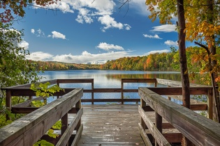 Blue skies and brilliant fall colors welcome you to this dock along Traverse City's Cedar Lake