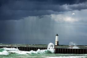 Rain, rays, and crashing waves all surround the Frankfort Lighthouse on Lake Michigan