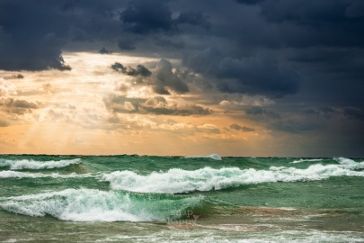 Warm sun rays and white-cap waves spill over on Lake Michigan