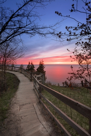 A red sunset over Lake Michigan on the Empire Bluffs boardwalk