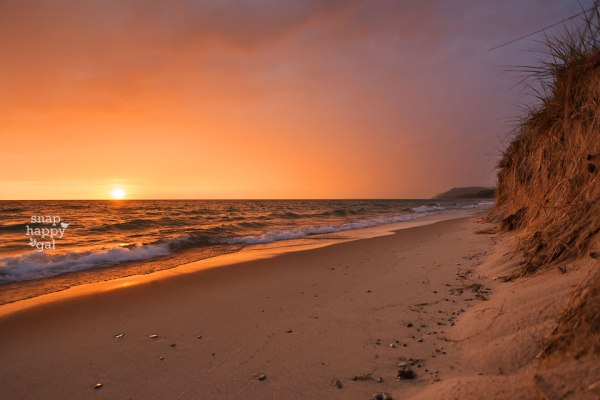 A fiery sunset glows on the beach in Empire, Michigan
