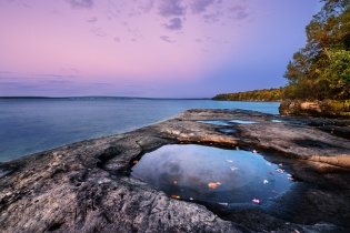 Twilight descends on the rocky shoreline of Lake Superior at Five Mile Point