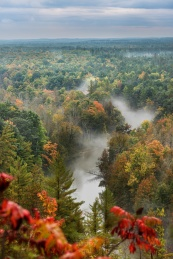 Fog rises out of the Manistee River valley in the early fall