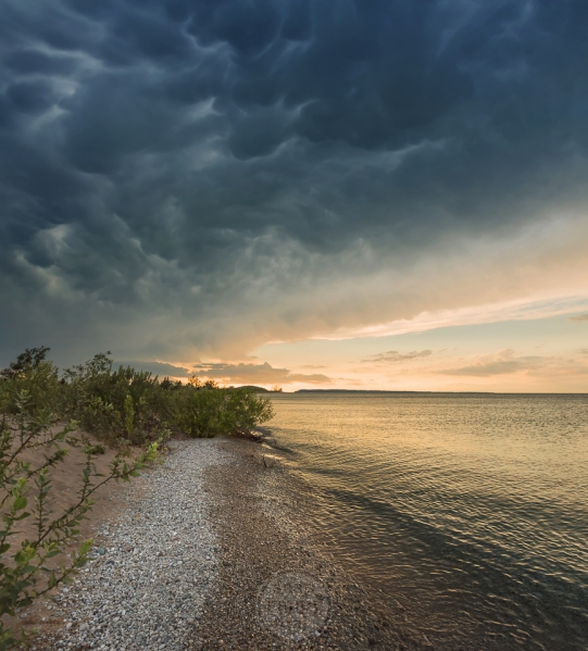 A storm front leaves roiling mammatus clouds in its wake over Sleeping Bear Point on Lake Michigan
