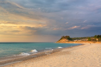 Photo: Warm sun lights the Point Betsie bluffs along Lake Michigan after a storm