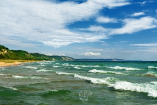 Photo: Waves roll in under sunny skies in Elberta