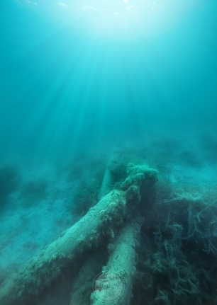 Light rays reach through Lake Michigan's depths to illuminate some long-submerged pilings
