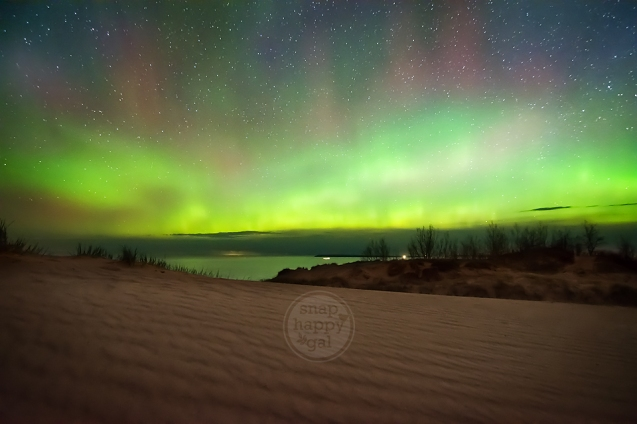 Photo: Northern Lights glow vividly over the shifting sands of Michigan's Sleeping Bear Dunes