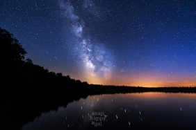 Light pollution joins the Milky Way and meteors over Loon Lake in northern Michigan