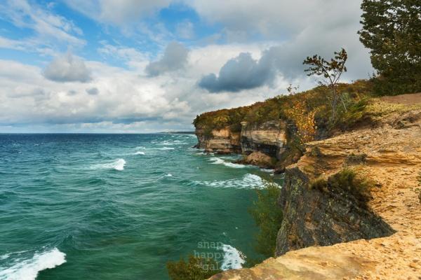 Lake Superior sparkles below the sandstone cliffs of Michigan's Pictured Rocks