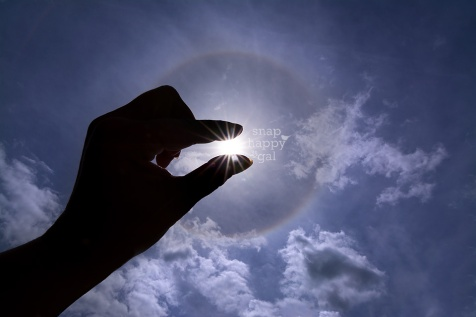 Photo: Silhouetted hand during a strong sun halo