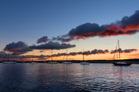 Photo: Red Cloud Train and Sailboats at Sunrise near Traverse City