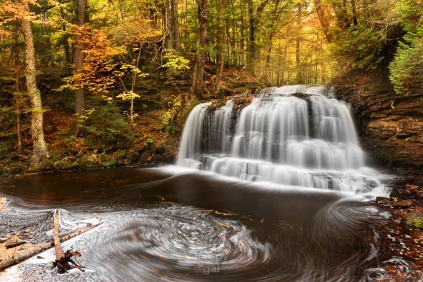 Upper Michigan's Rock River Falls in gorgeous fall light plummets over a rocky face into swirling waters