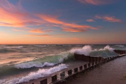 Rolling Lake Michigan waves crash on the beach
