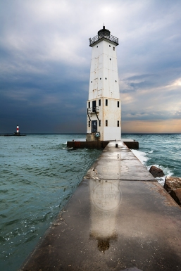 Photo: Michigan's Frankfort Lighthouse reflects off the wet pier after a passing spring storm