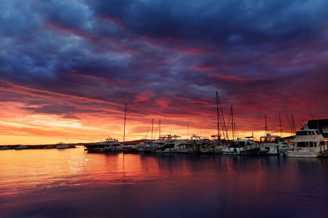 Photo: A brilliant sunrise plays out over boats in the Traverse City Clinch Marina