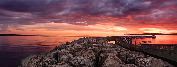 Photo: A fiery sunrise glows over Traverse City's stone breakwall
