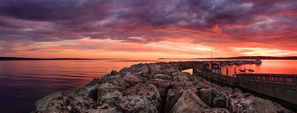 Photo: A fiery sunrise glows over Traverse City's stone breakwall
