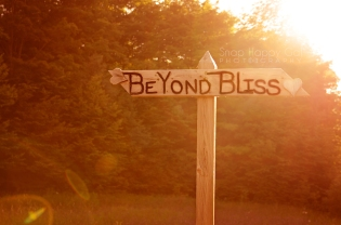 Photo: Follow your bliss, beyond bliss road sign, bokeh, lens flare