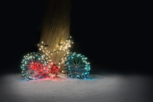 Photo: Christmas lights on a bicycle in the snow