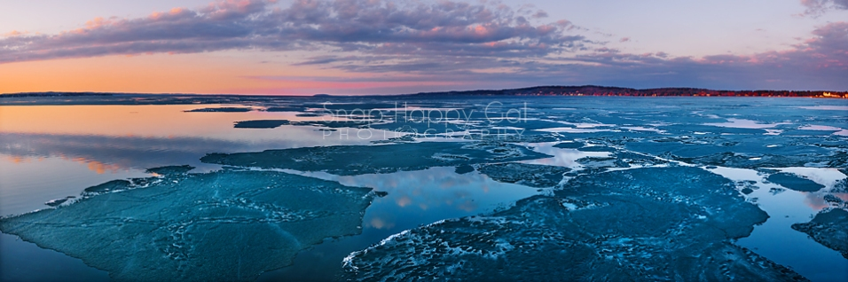 Photo: Partially frozen Grand Traverse Bay, colorful sunset