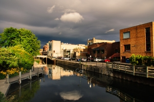 Photo: Warm light bathes the Boardman River and Traverse City skyline during a storm