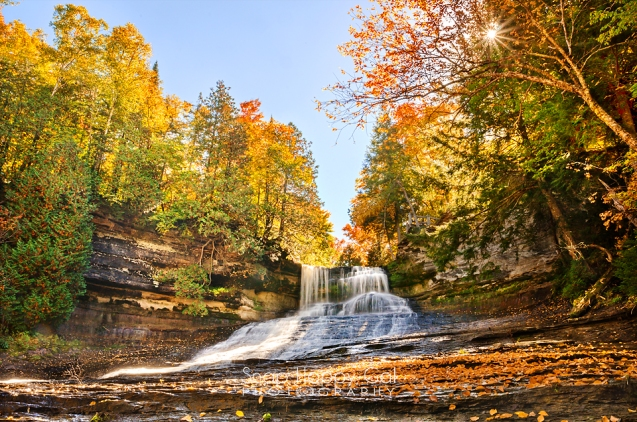 Photo: fall color and a sunburst at Laughing Whitefish Falls waterfall
