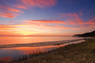 Photo: A vibrant sunset over Lake Michigan at Otter Creek - Esch Road Beach