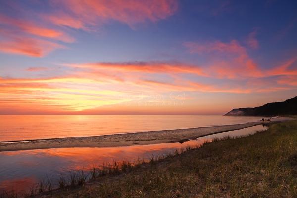 Photo: A vibrant sunset over Lake Michigan at Otter Creek - Esch Road Beach