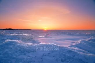 Photo: fiery sunset over frozen Lake Michigan, Northport