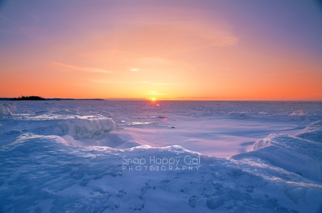 Photo: fiery sunset over frozen Lake Michigan, Northport