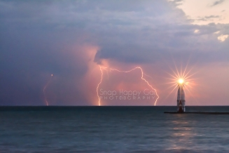 Photo: Lightning and a starburst light up Lake Michigan and the Frankfort Lighthouse