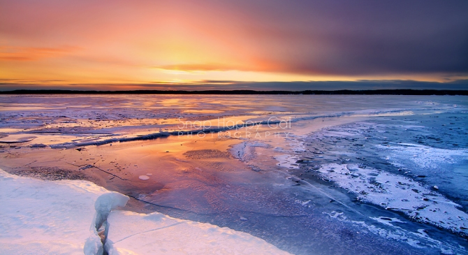 Glowing Sunset Over Frozen Torch Lake