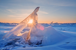 Photo: A sun star glimmers through a Lake Michigan ice formation