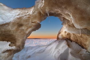 Photo: sunset viewed from inside an ice cave on Lake Michigan