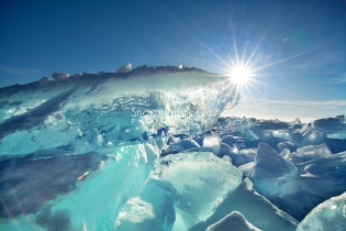Photo: Sun shines on thick, blue ice on Lake Michigan