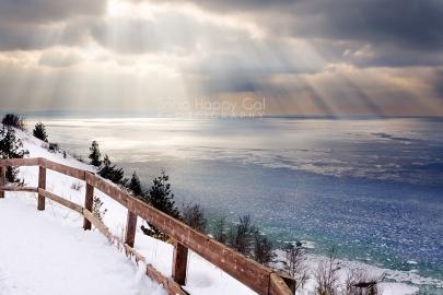 Photo: Sun rays shine down on a freezing Lake Michigan