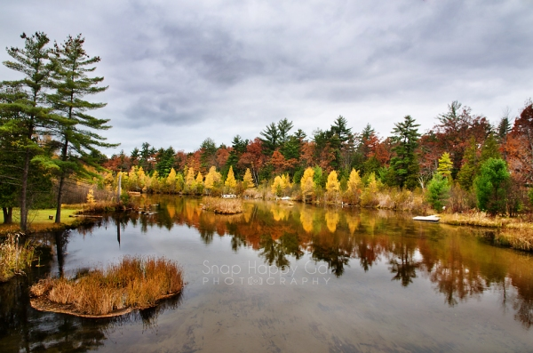 Photo: larches and oaks reflect in a river