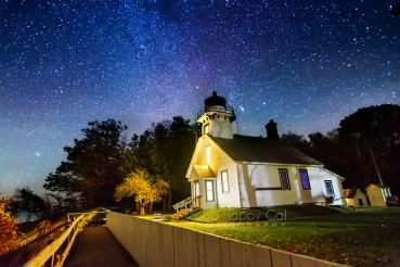 Photo: Mission Point Lighthouse under the night sky