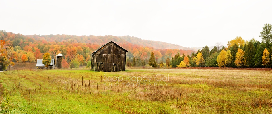 Photo: Panorama - An old farmstead sits in a valley full of fall color