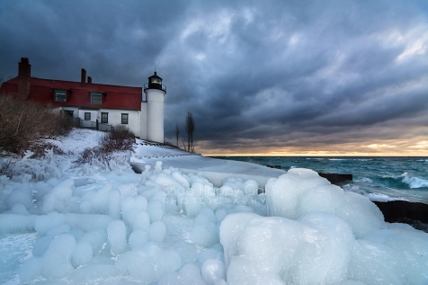 Photo: moody skies, ice formations at Point Betsie Lighthouse