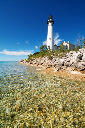 Photo: South Manitou Lighthouse perched above the clear Lake Michigan water
