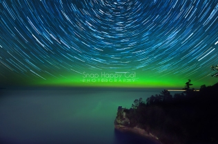 Photo: Star trails and aurora over Miners Castle