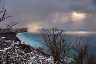 Photo: lake effect snow, sun rays, Lake Michigan