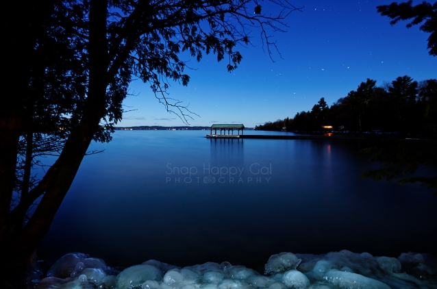 Photo: tree silhouettes, boathouse, stars