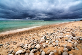 Photo: Dark clouds, Lake Michigan beach with stones